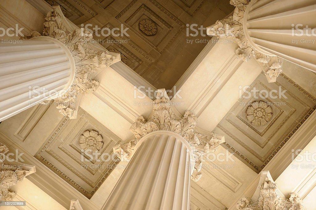 View upwards beneath neoclassical columns stock photo