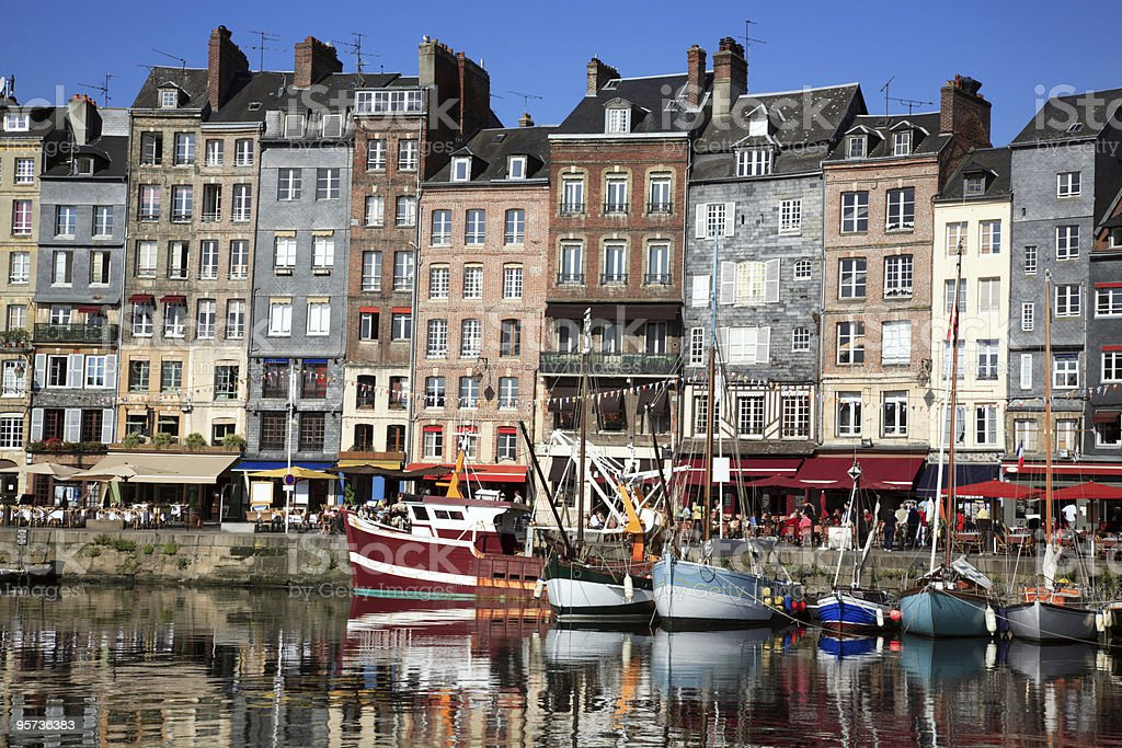 A view with boats in the water in Honfleur, France stock photo