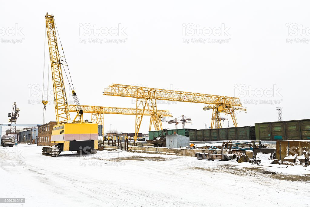 view with different cranes in open storage area stock photo