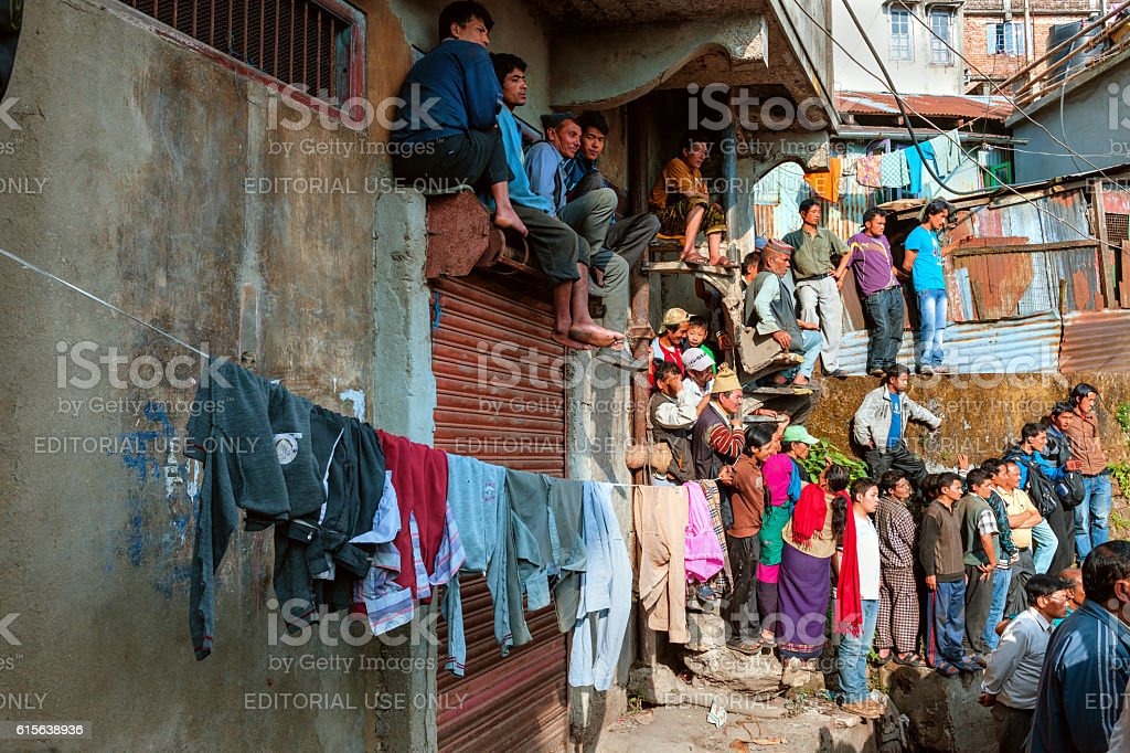 Viewers of volleyball matches on the walls,Darjeeling, India stock photo