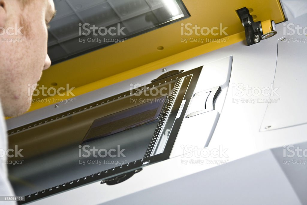 Viewing a transparency on scanner stock photo