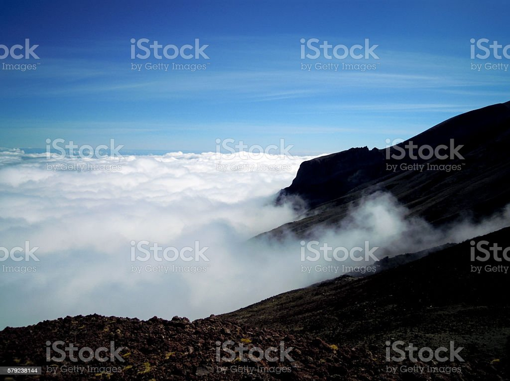 Viewing over the clouds stock photo