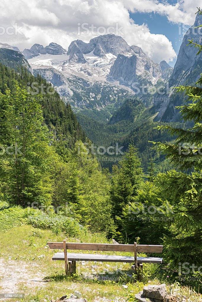 Viewpoint with Bench overlooking the famous Glacier Dachstein, Austrian Alps stock photo