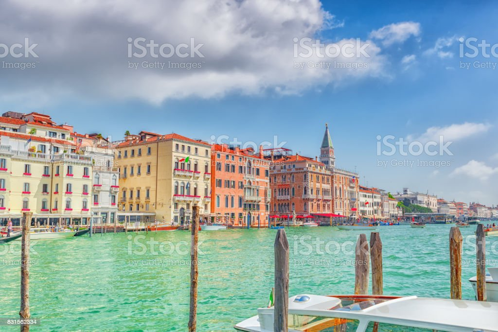 Views of the most beautiful canal of Venice - Grand Canal water streets, and Campanile of St. Mark's Cathedral (Campanile di San Marco). stock photo