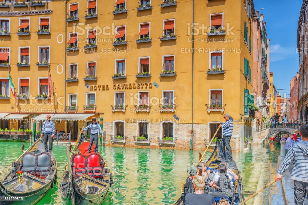 Venice,  Italy - May 12, 2017 : Views of the most beautiful channel of Venice, narrow streets, houses, gondolas and gondoliers with tourists. stock photo
