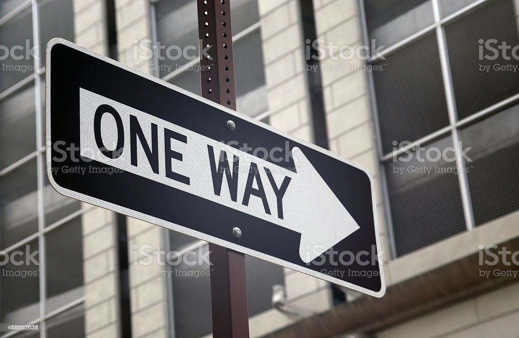 Vignetted One way sign in a city stock photo