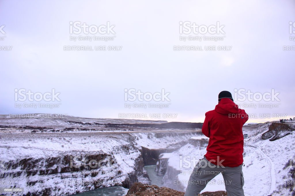Vik, Iceland - FEB 22th, 2017: A man standing on the cliff stock photo