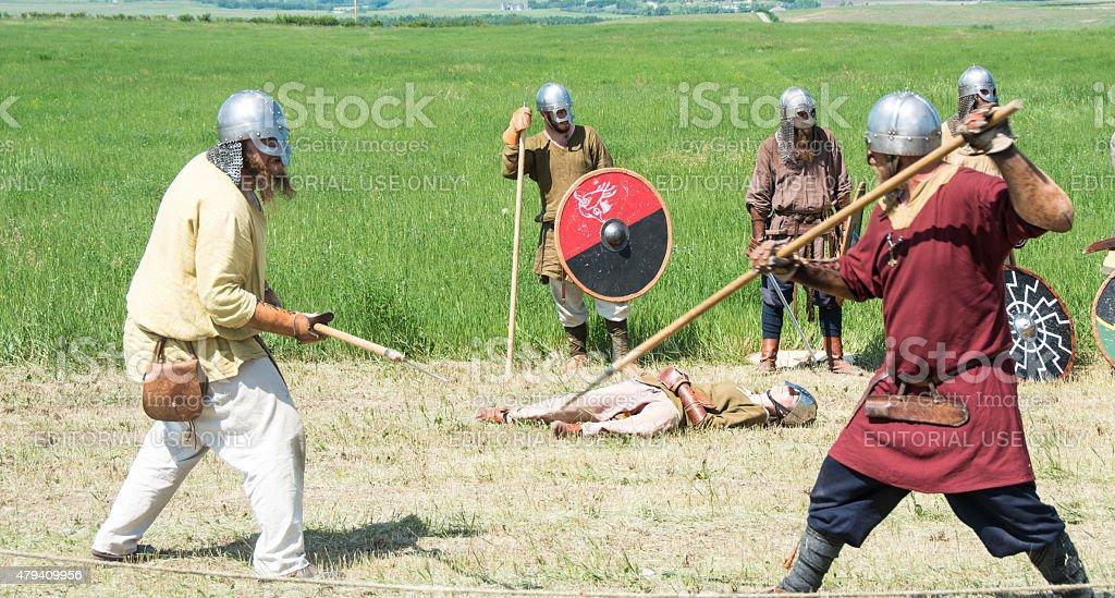 Viking battle reenactment in full  dress fighting one on one stock photo