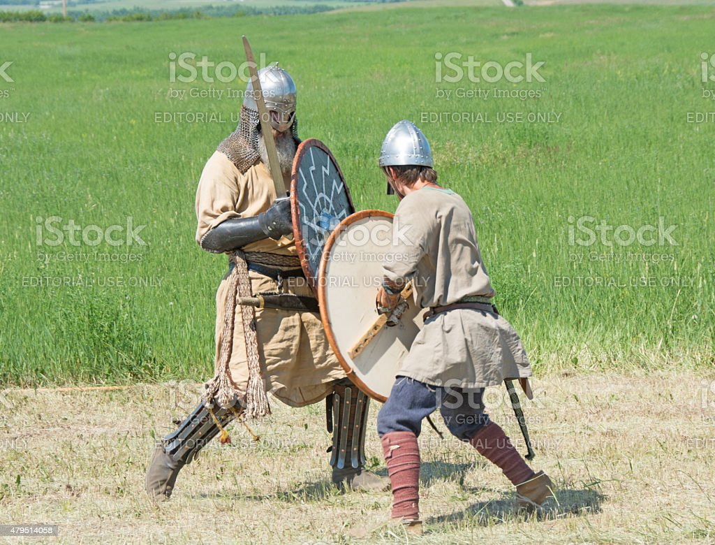 Viking battle reenactment in full  dress fighting one on one stock photo
