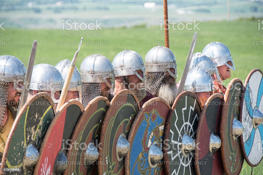 Viking battle reenactment in full Viking dress making arrow shield stock photo