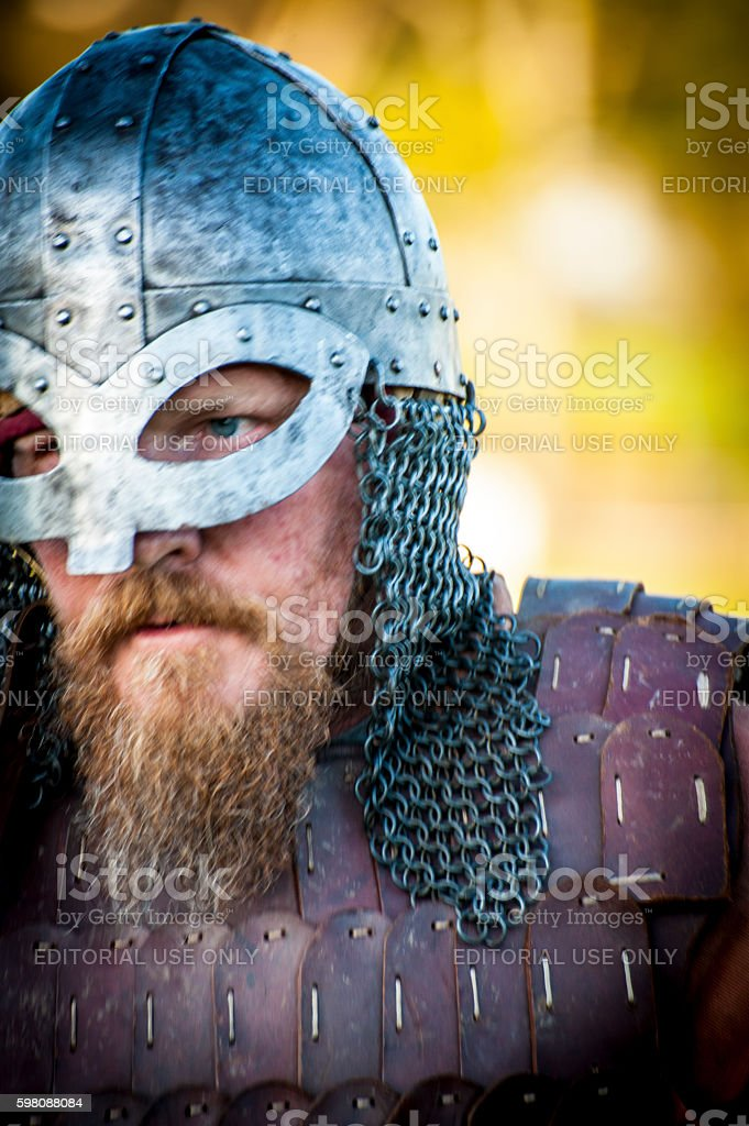 Viking re enactment soldier goes in to fight stock photo