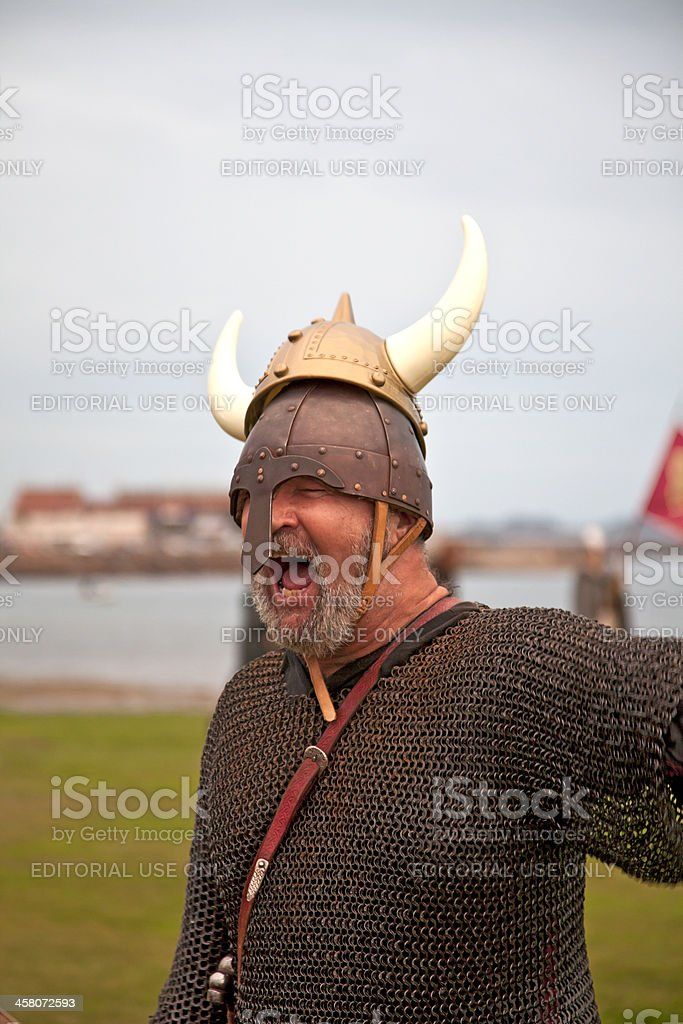 Viking re-enactor feigning fury at a horned helmet stock photo