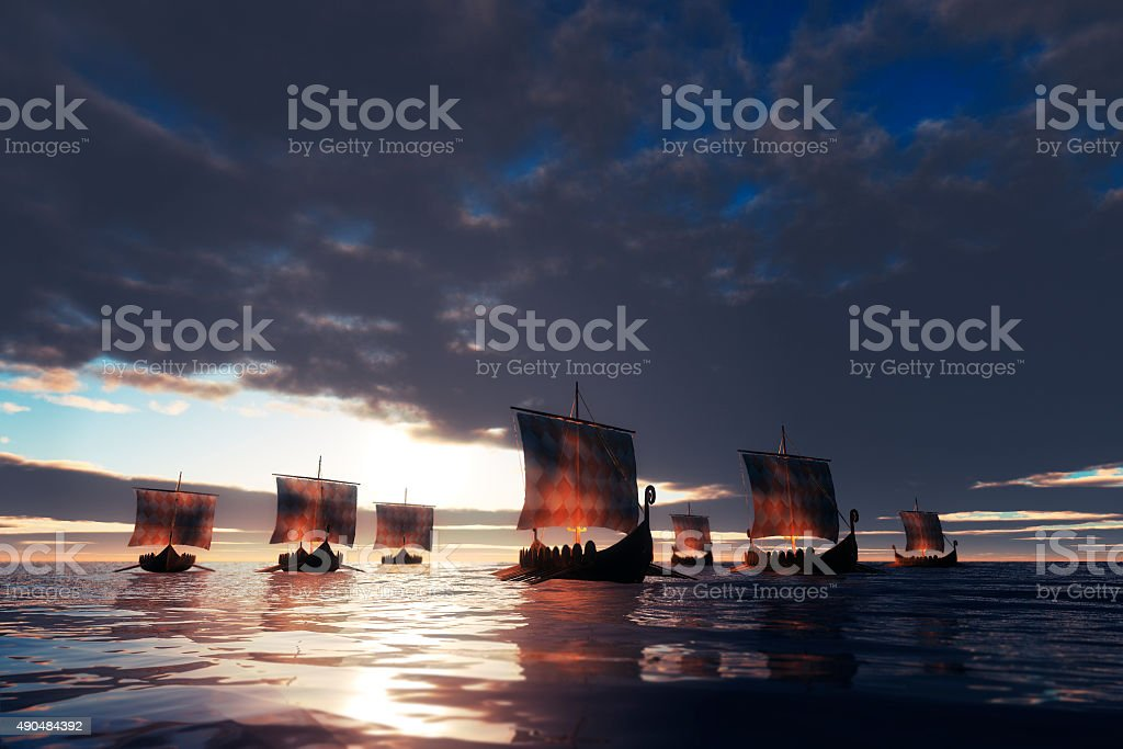 Viking ships sailing towards unknown land stock photo