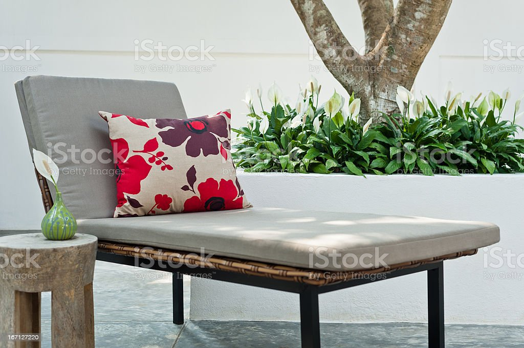 Villa garden with lounger and pillow royalty-free stock photo