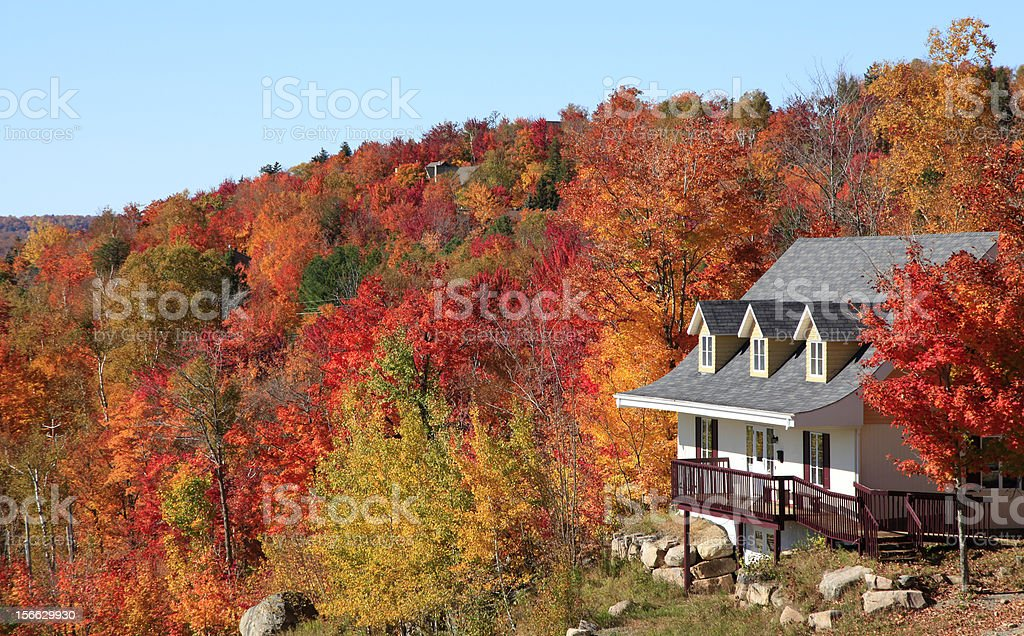 Villa in autumn, Mont Tremblant, Quebec, Canada stock photo