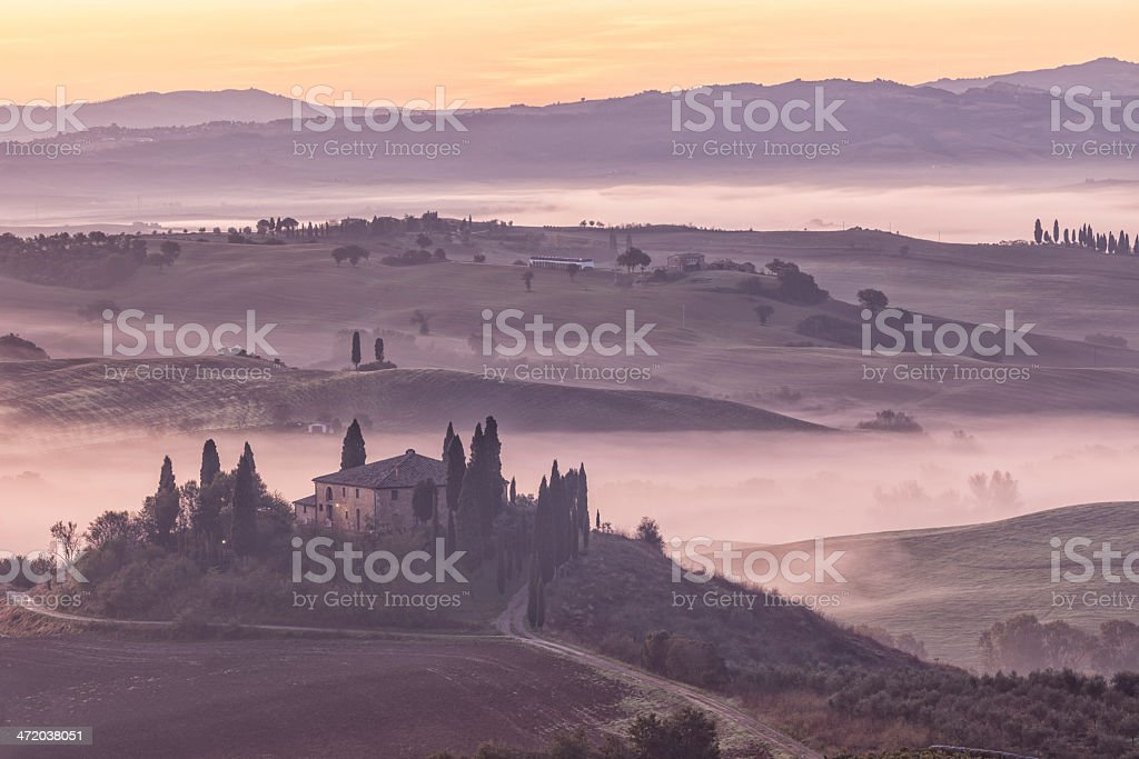 Villa in Misty Rolling Landscape at Dawn, Tuscany, Italy royalty-free stock photo