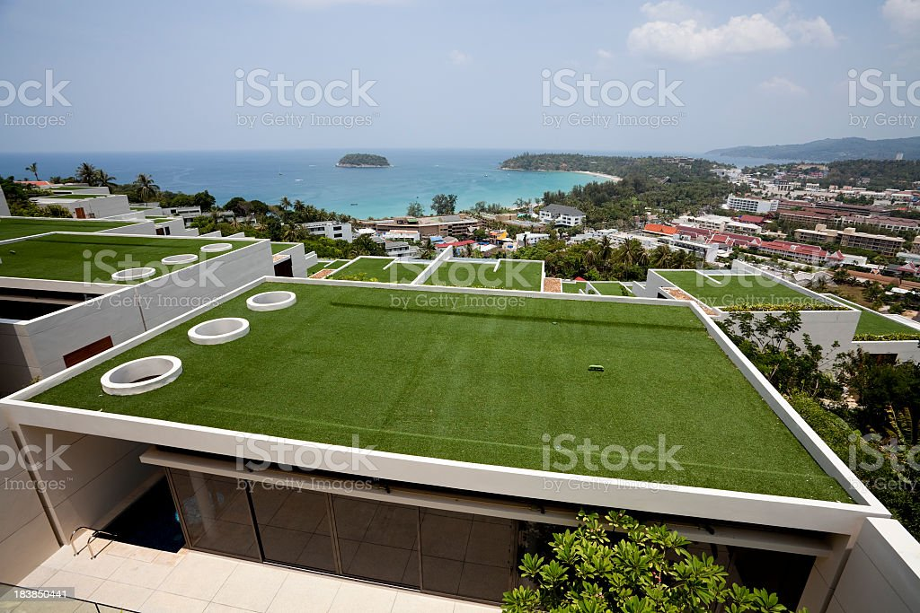 Villa rooftop overlooking a beautiful view of the beach royalty-free stock photo