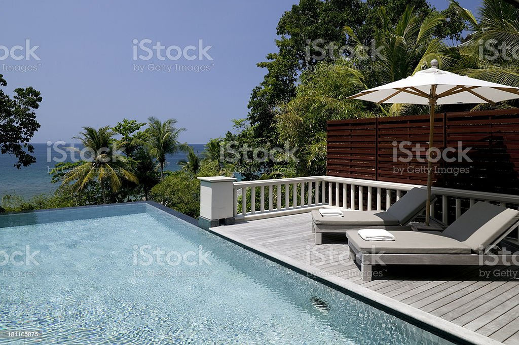 villa swimming pool beach house waterfront royalty-free stock photo