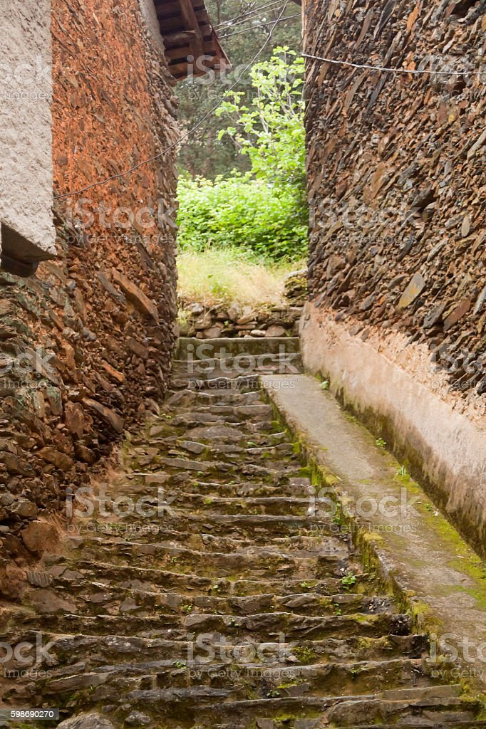 Village alley with staircase. stock photo