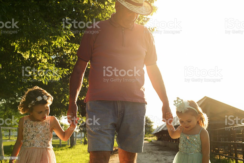 Village and grand parenting. stock photo