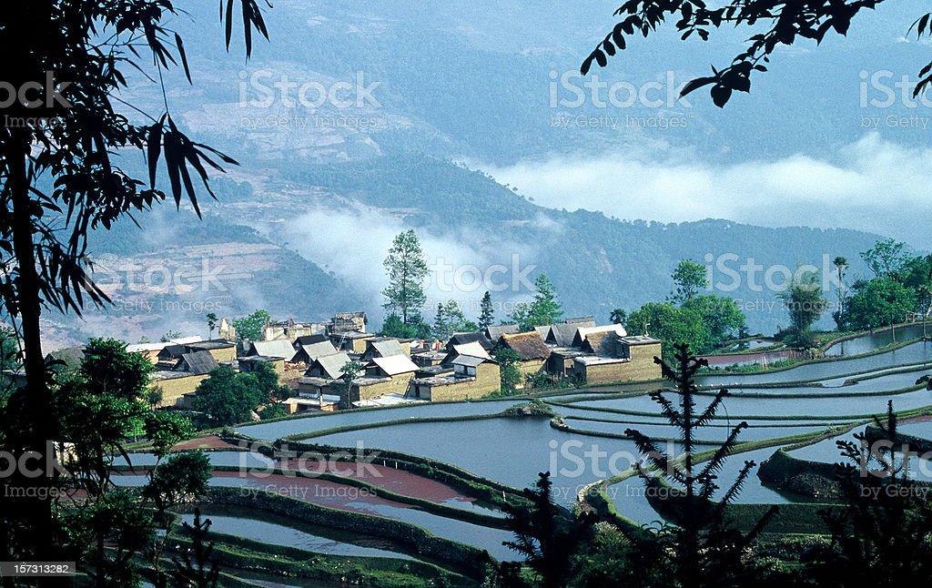 Village and Rice Terraces in Yuanyang, Yunnan, China stock photo