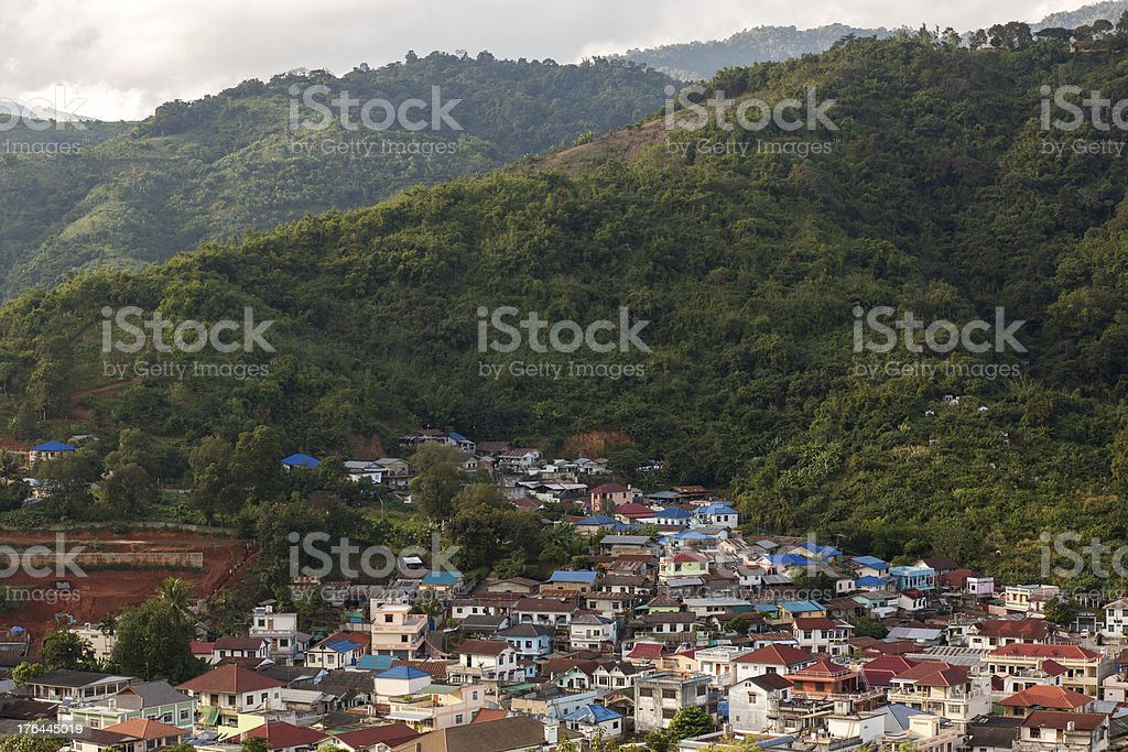 Village beside green mountain royalty-free stock photo