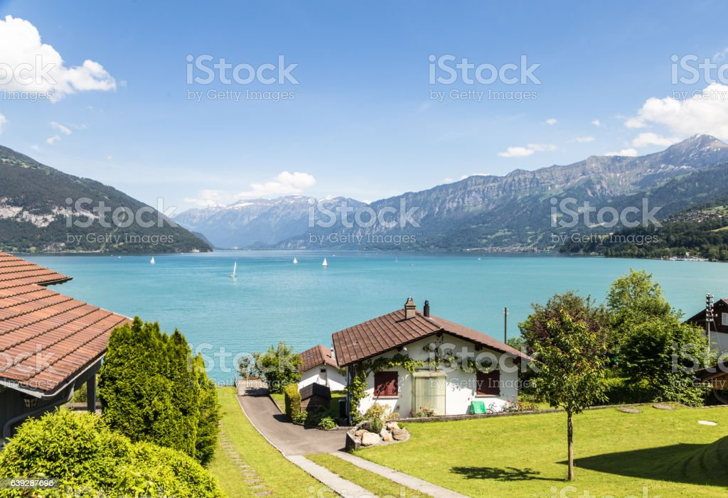 Village by lake Thun in Canton Bern, Switzerland stock photo
