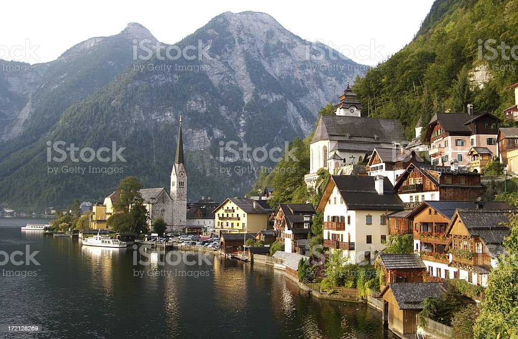 Village by the water with mountains in Hallstatt Austria stock photo