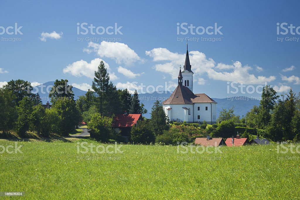 Village church and mountain landscape royalty-free stock photo
