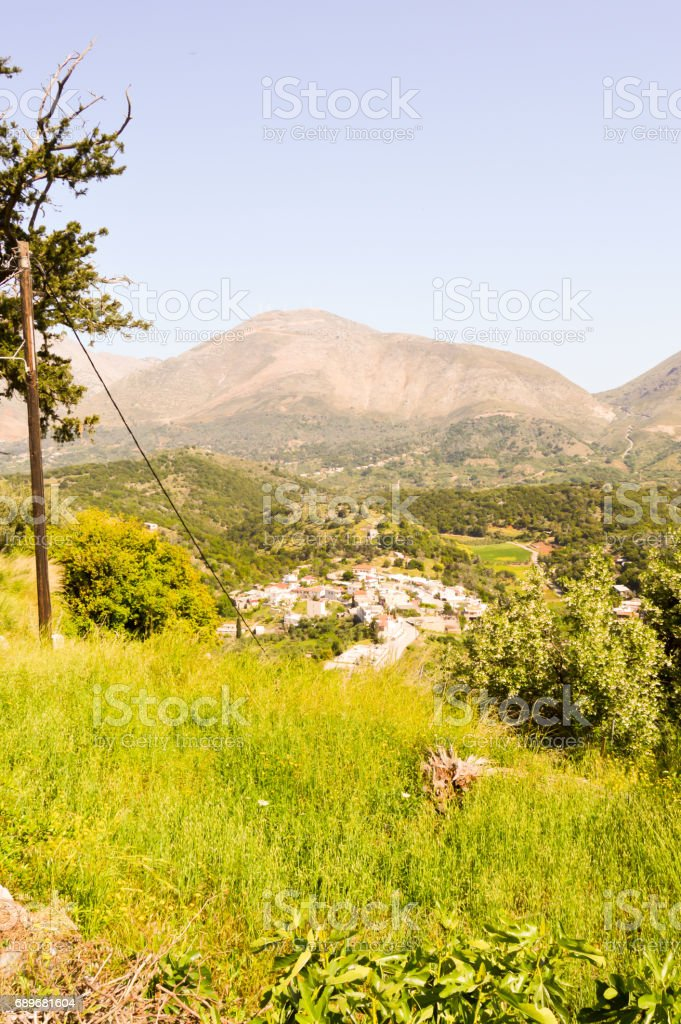 Village Cretan perched on a hill among stock photo