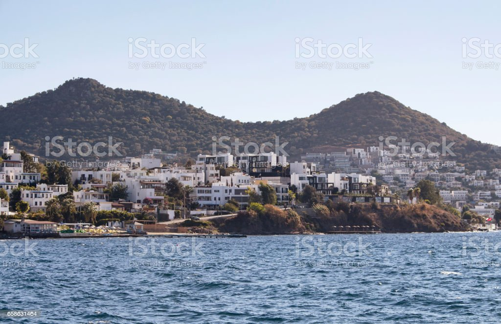 Village full of summer houses in Yalikavak area in Bodrum peninsula. Architectural style of the region is all white homes. stock photo