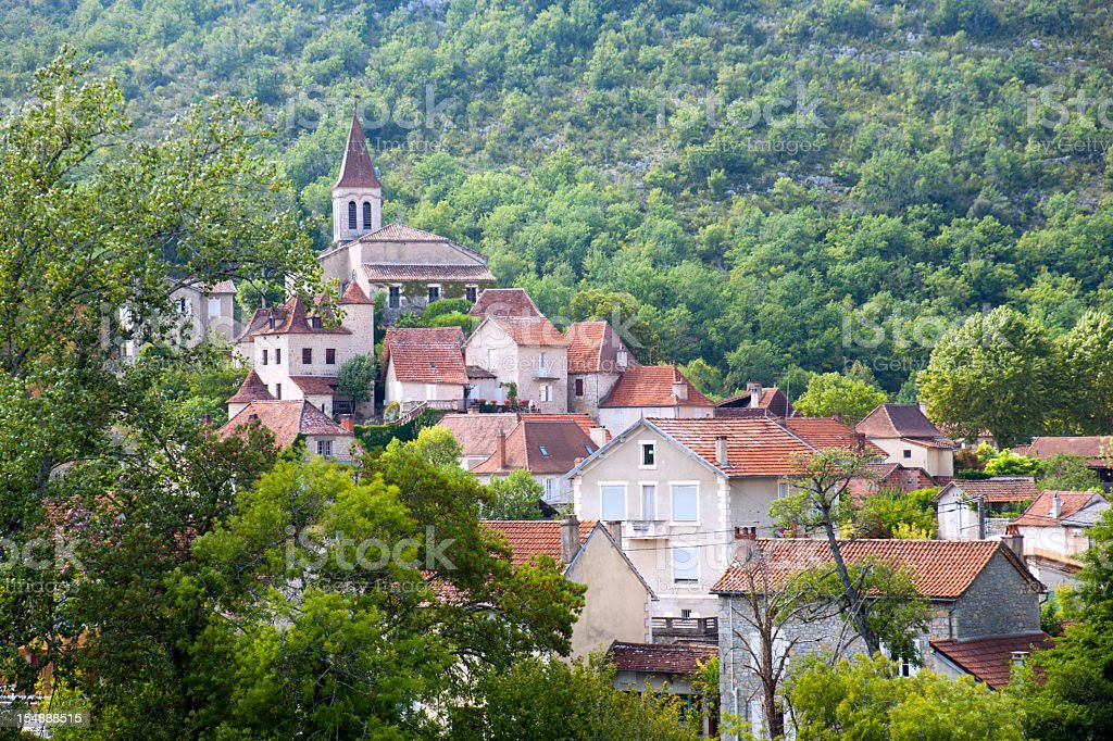 Village houses surround the church in Cabrerets, Lot, France, Europe stock photo