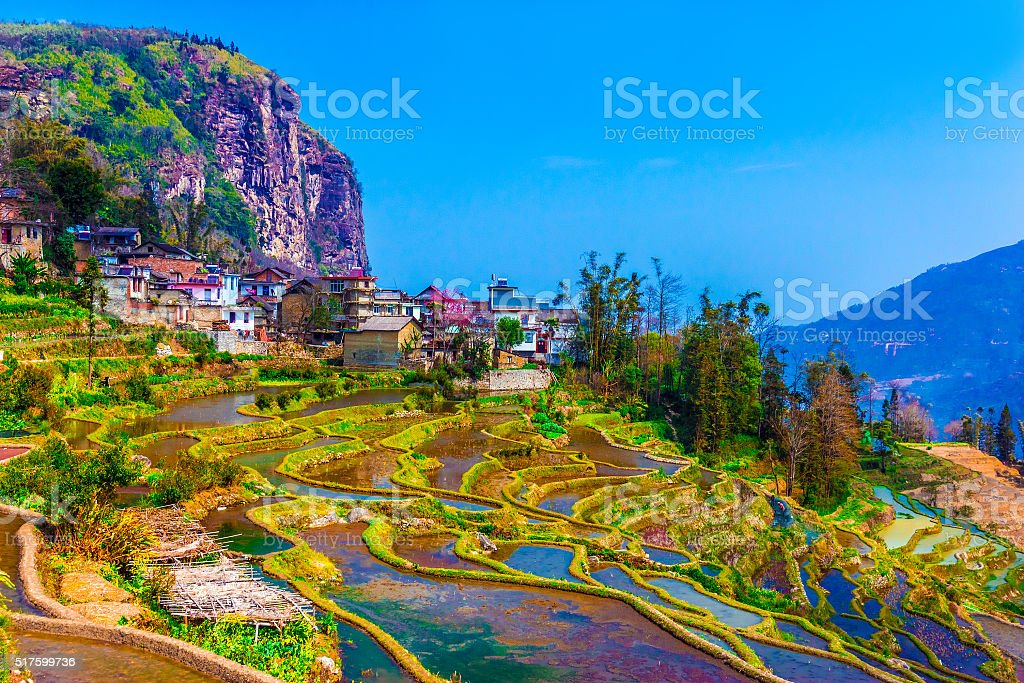 Village in South China with traditional Houses and Rice Terraces stock photo