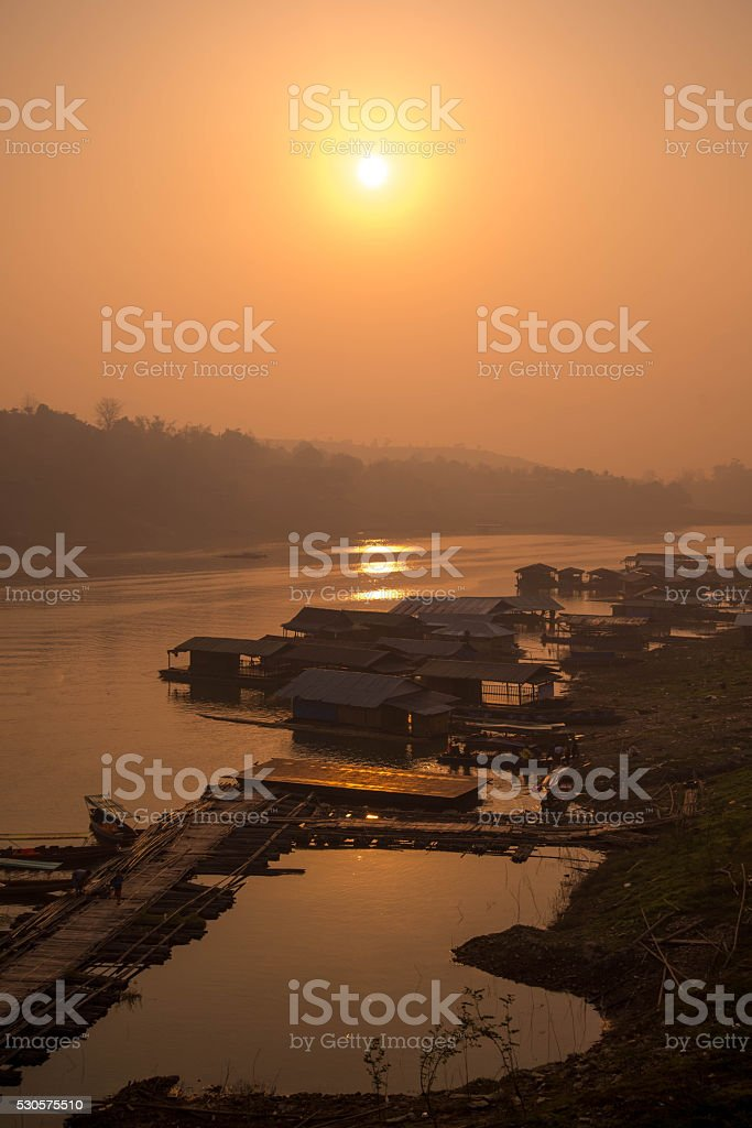 Village near river at sangklaburi, Kanchanaburi,Thailand. stock photo