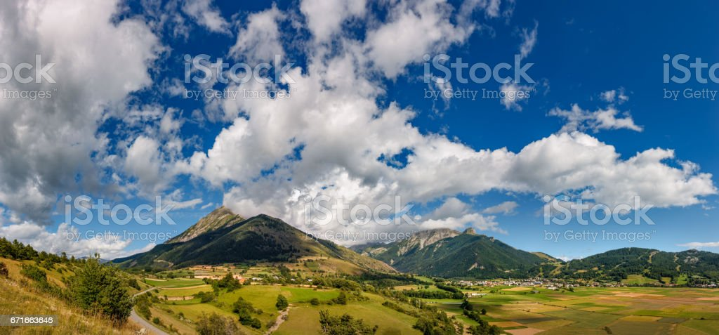 Village of Ancelle and the Autane mountain peaks in Summer. Hautes Alpes, France stock photo