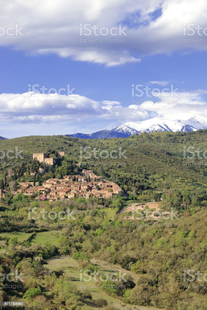 Village of Castelnou and peak of Canigou in Pyrenees orientales,  France stock photo