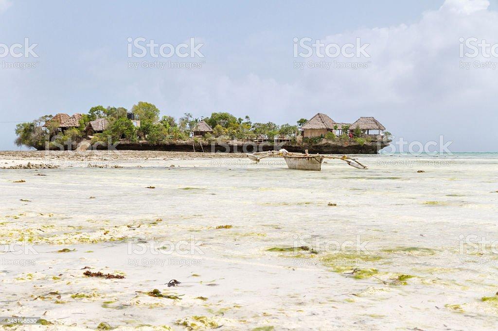 Village of fishermen in Zanzibar at low tide stock photo