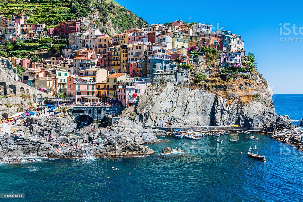 Village of Manarola with ferry, Cinque Terre, Italy stock photo