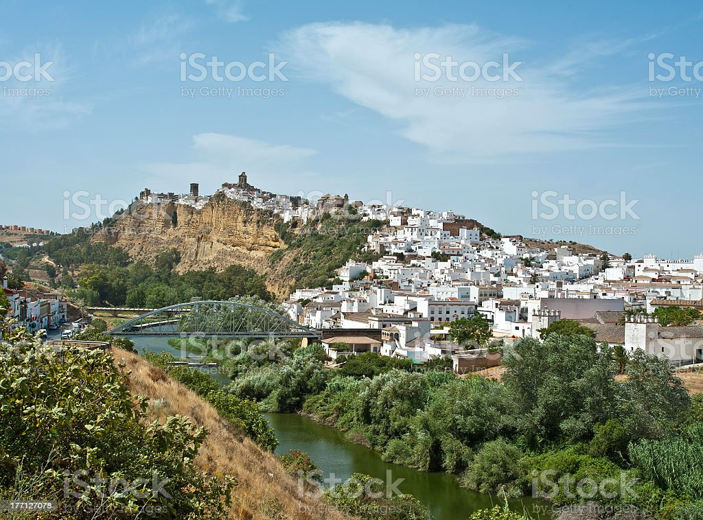 Village on a hill along a river stock photo