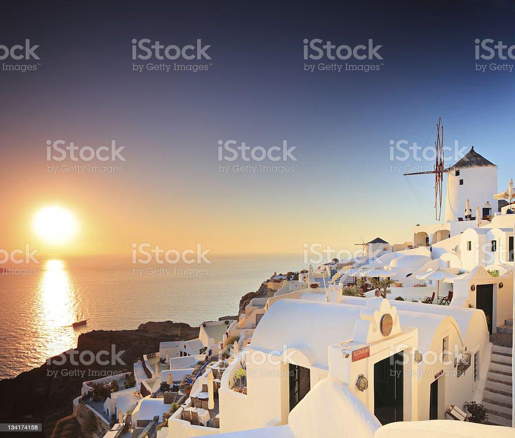 Village on Santorini island and a sunset royalty-free stock photo