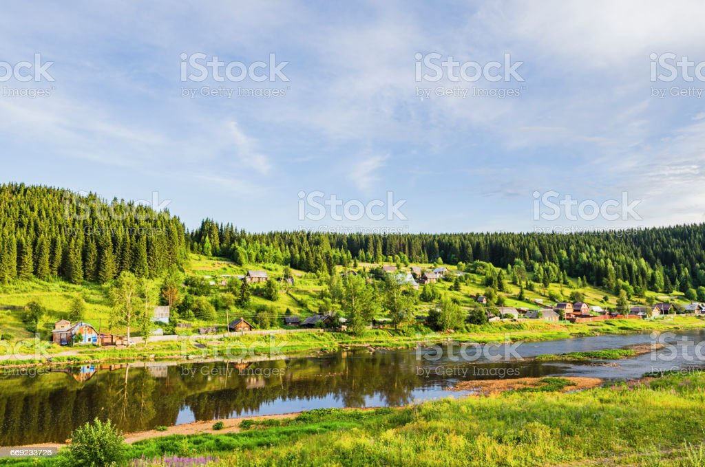 Village on the banks of the river stock photo