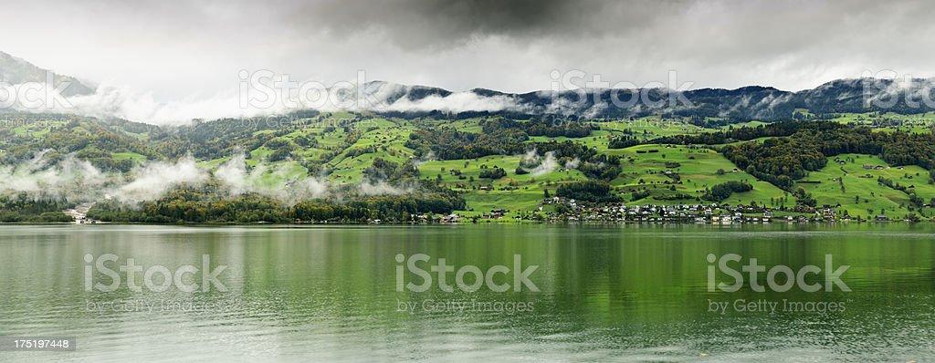 Village panorama on the edge of Swiss lake stock photo