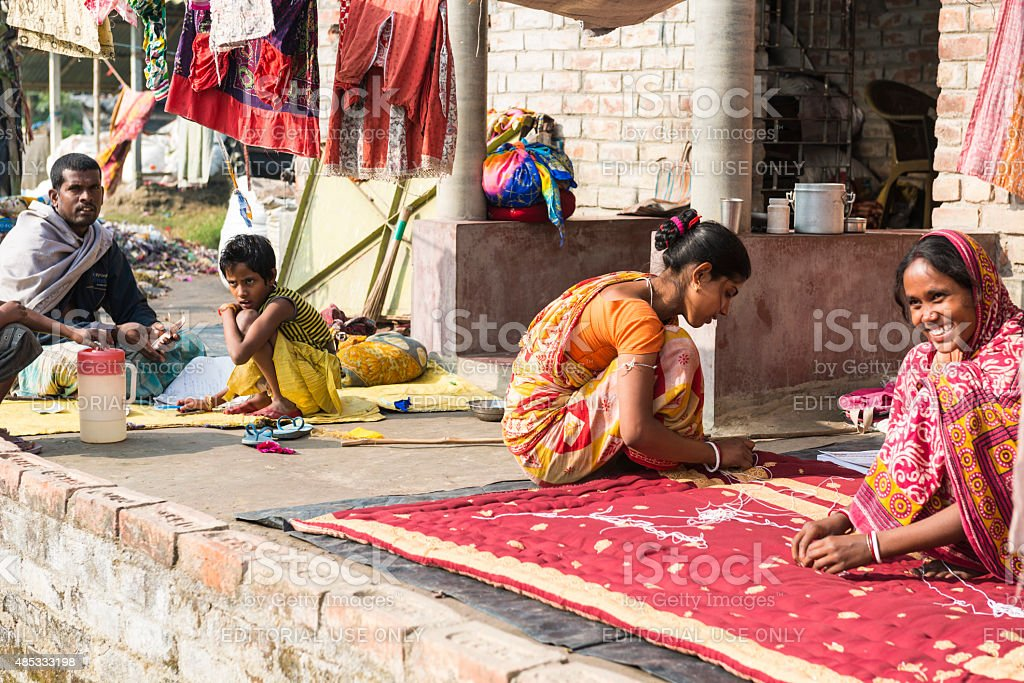 Village people make colorful quilts in India stock photo