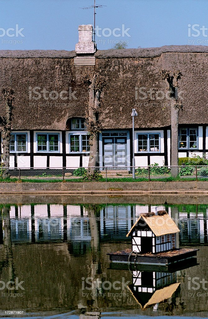Village Pond – with a Half-timbered House royalty-free stock photo
