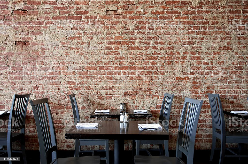 Village Pub Brick Wall with Tables and Chairs royalty-free stock photo