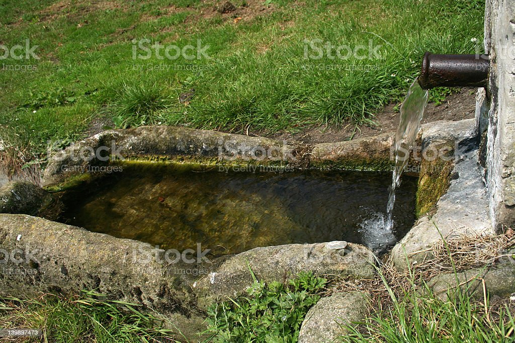 Village water trough stock photo