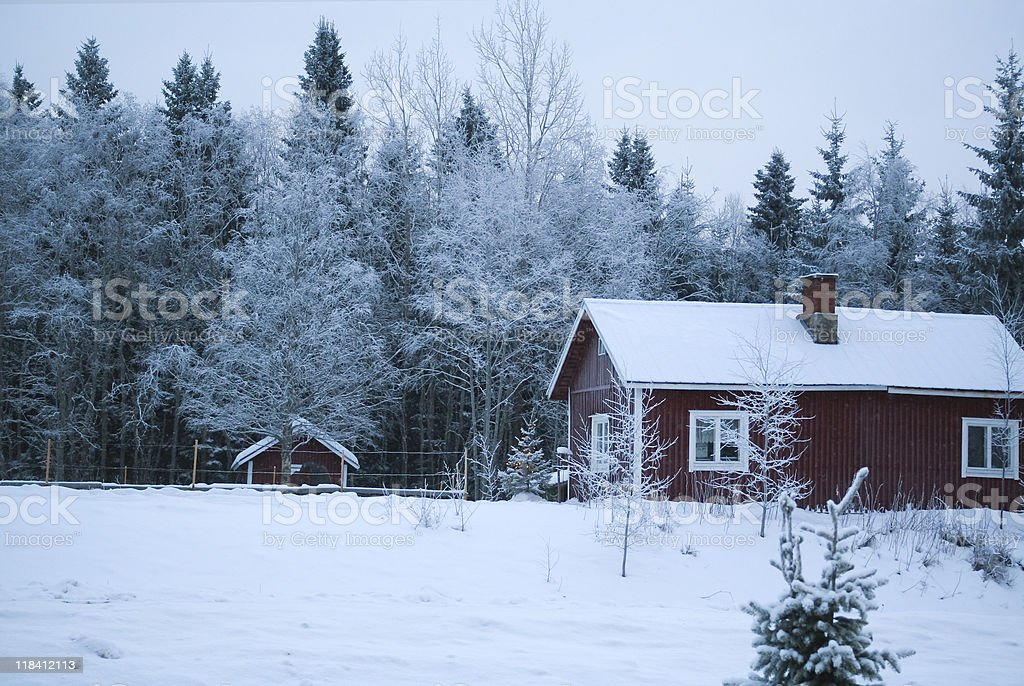 Village winter / Christmas   wooden house under snow royalty-free stock photo