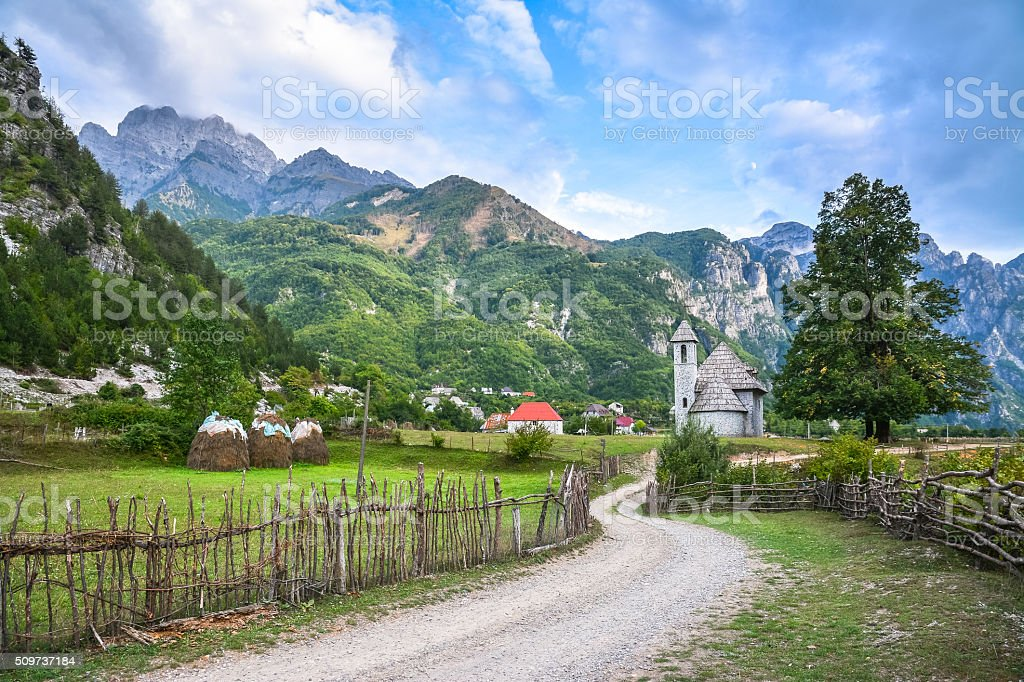 Village with an ancient church in the mountains stock photo