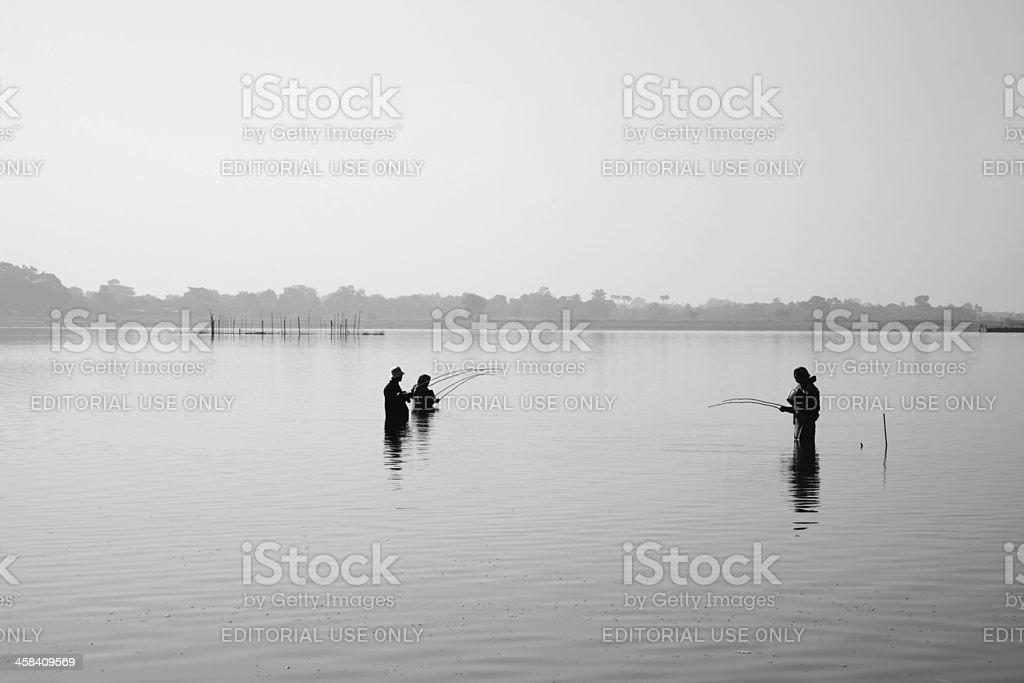 Villager Fishing at Taungthaman Lake, Amarapura Myanmar ( Burma ) royalty-free stock photo