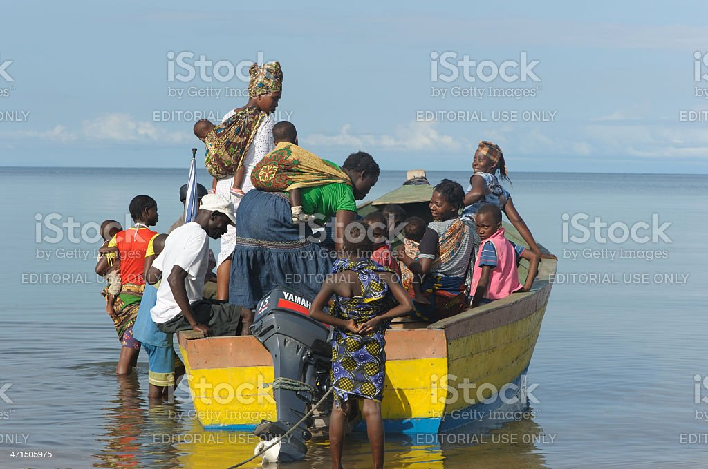 Villagers boarding a boat on Lake malawi royalty-free stock photo